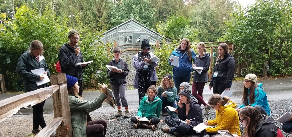 students in the Graduate Program in Environmental Education & Equity, reading