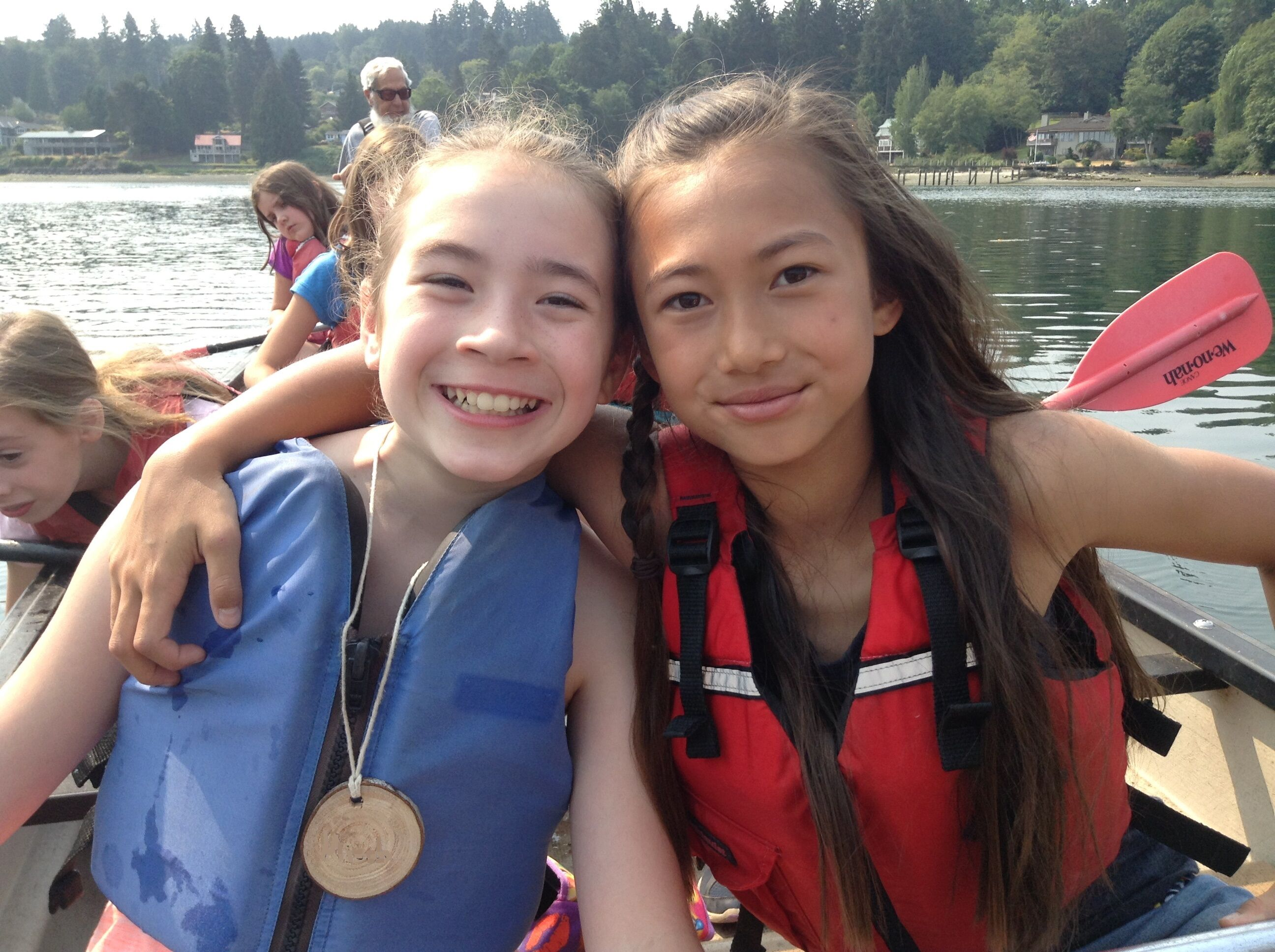 Two kids in a canoe at IslandWood's Outdoor Summer Day Camps
