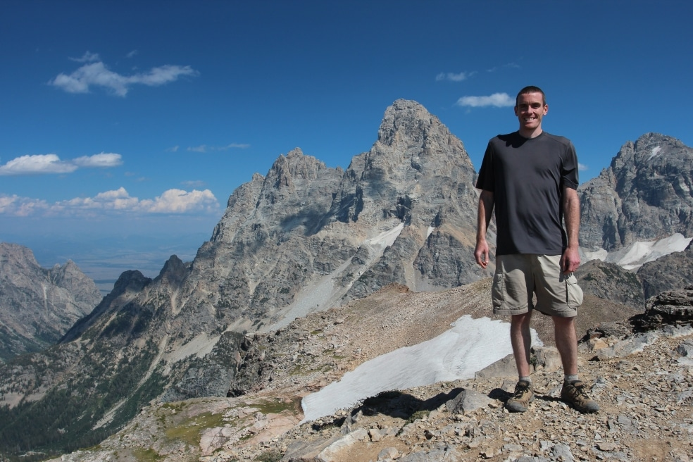 IslandWood Graduate Program alum Joe Petrick, hiking in the mountains.