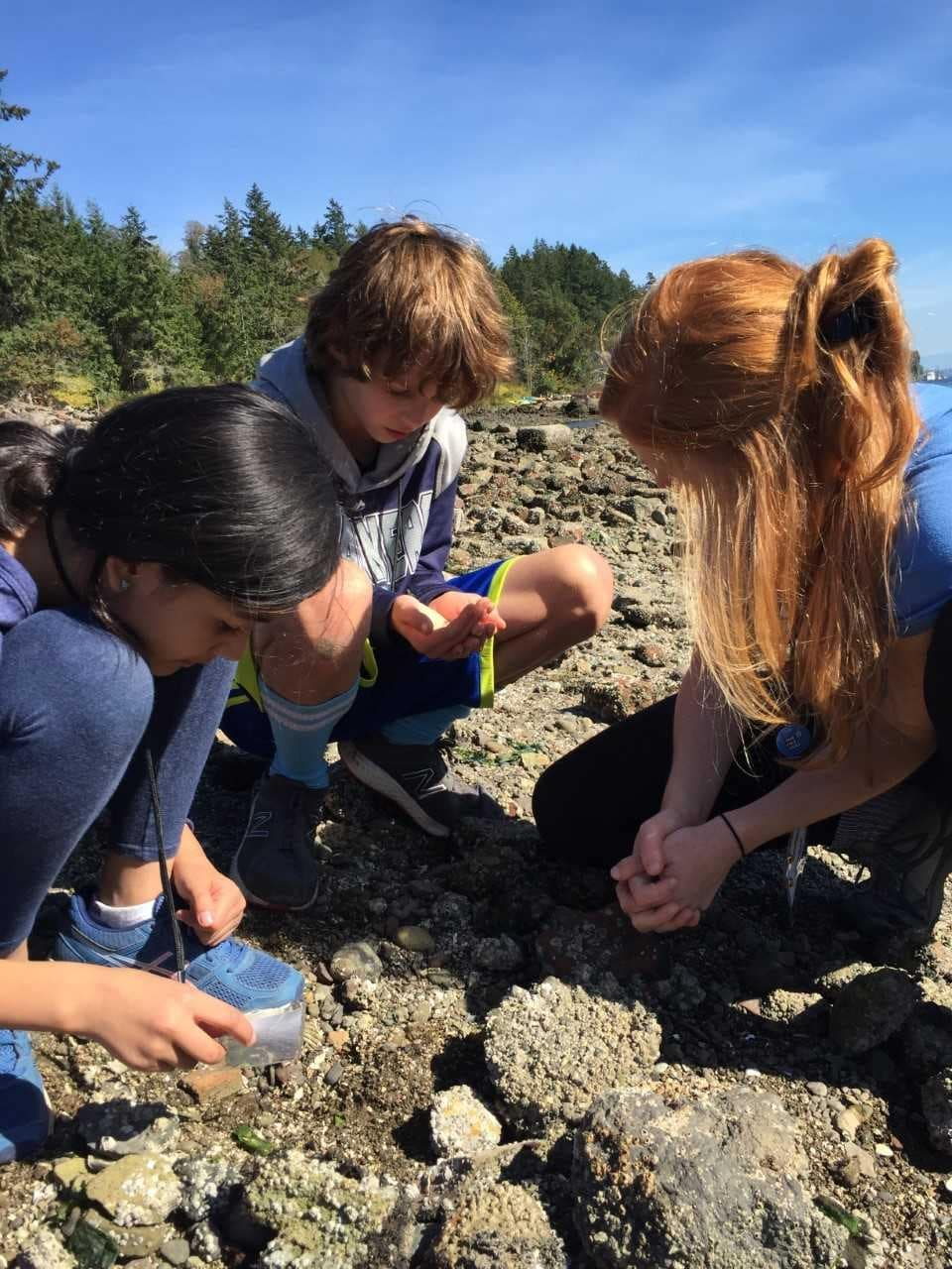 Hannah Levy and School Overnight Program students explore the beach.