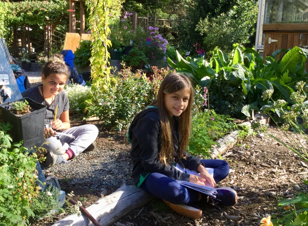 Two School Overnight Program students explore the garden.