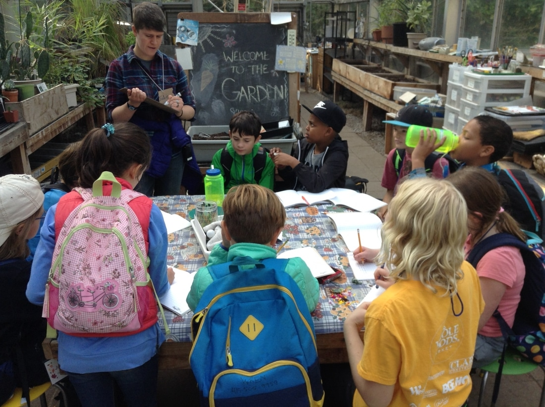 School Overnight Program students talk with their instructor in the Garden Classroom.
