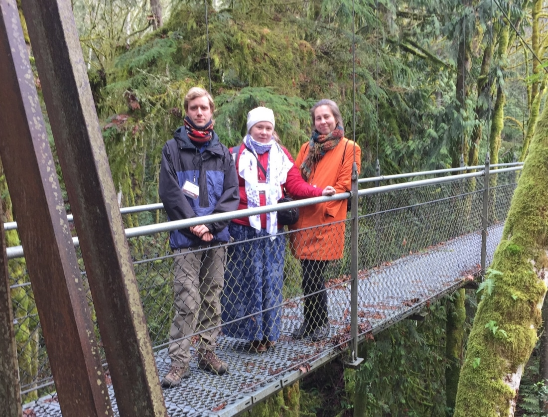 Visiting Russian teachers stand on the suspension bridge.