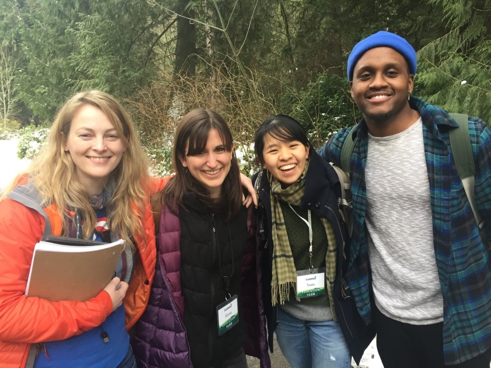 IslandWood graduate student Kelvin Washington smiles for the camera with three of his fellow graduate students.