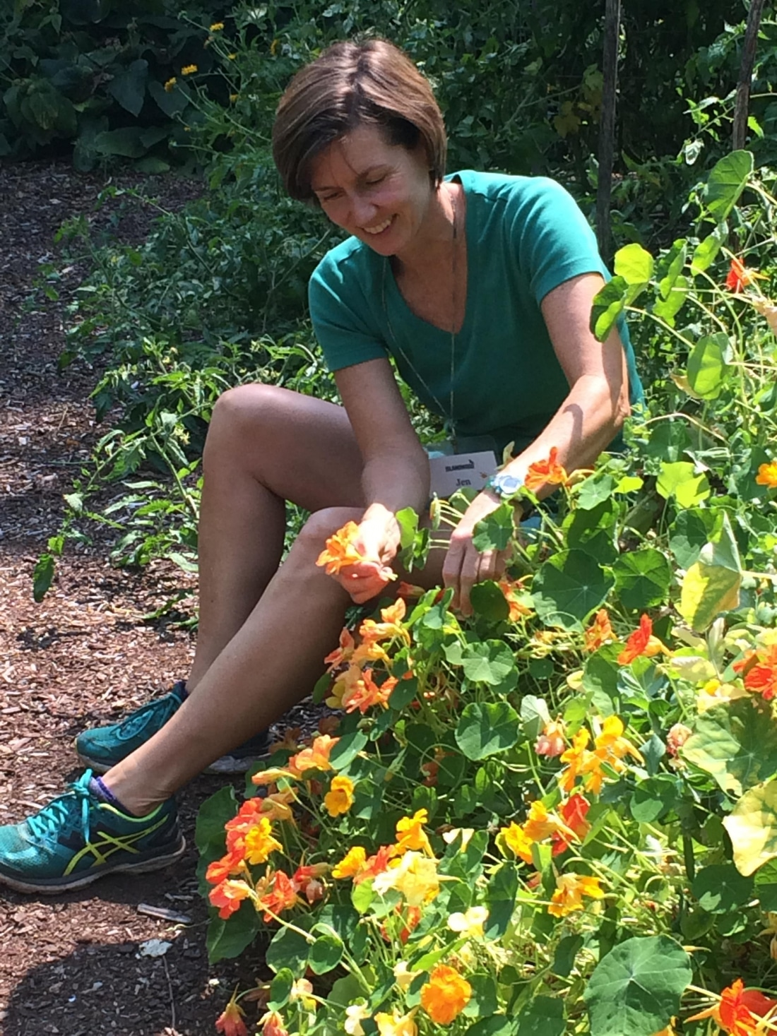 Garden Educator Jen Prodzinksi in the garden.