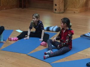 Students resting between yoga poses.