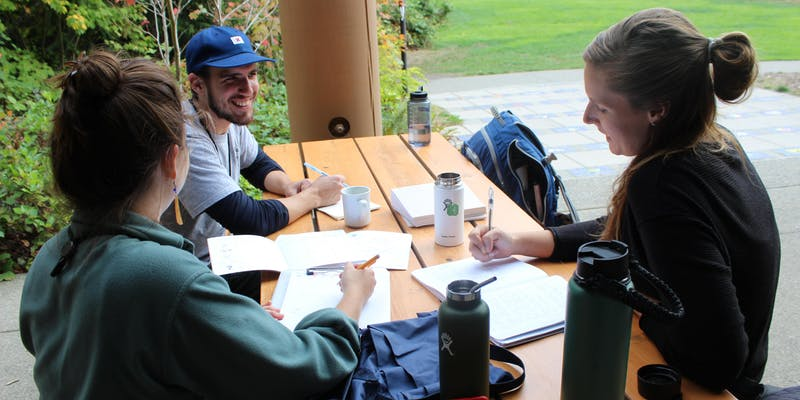 IslandWood graduate students talking and collaborating on the Bainbridge Island campus.