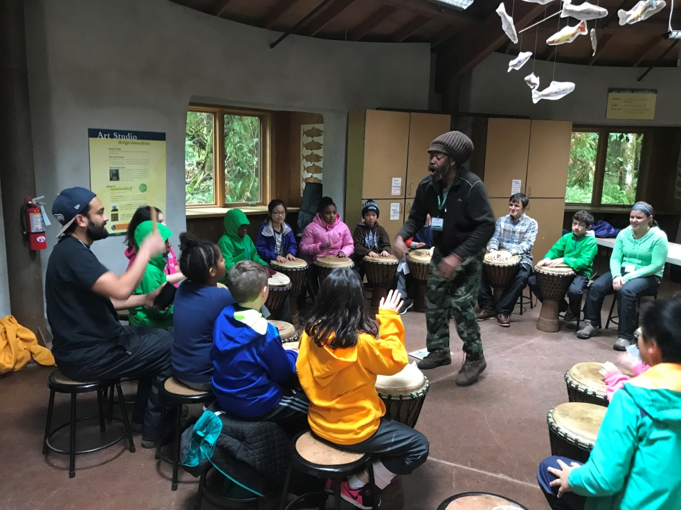Artist-in-Residence Jah Breeze drumming with students in the Art Studio.