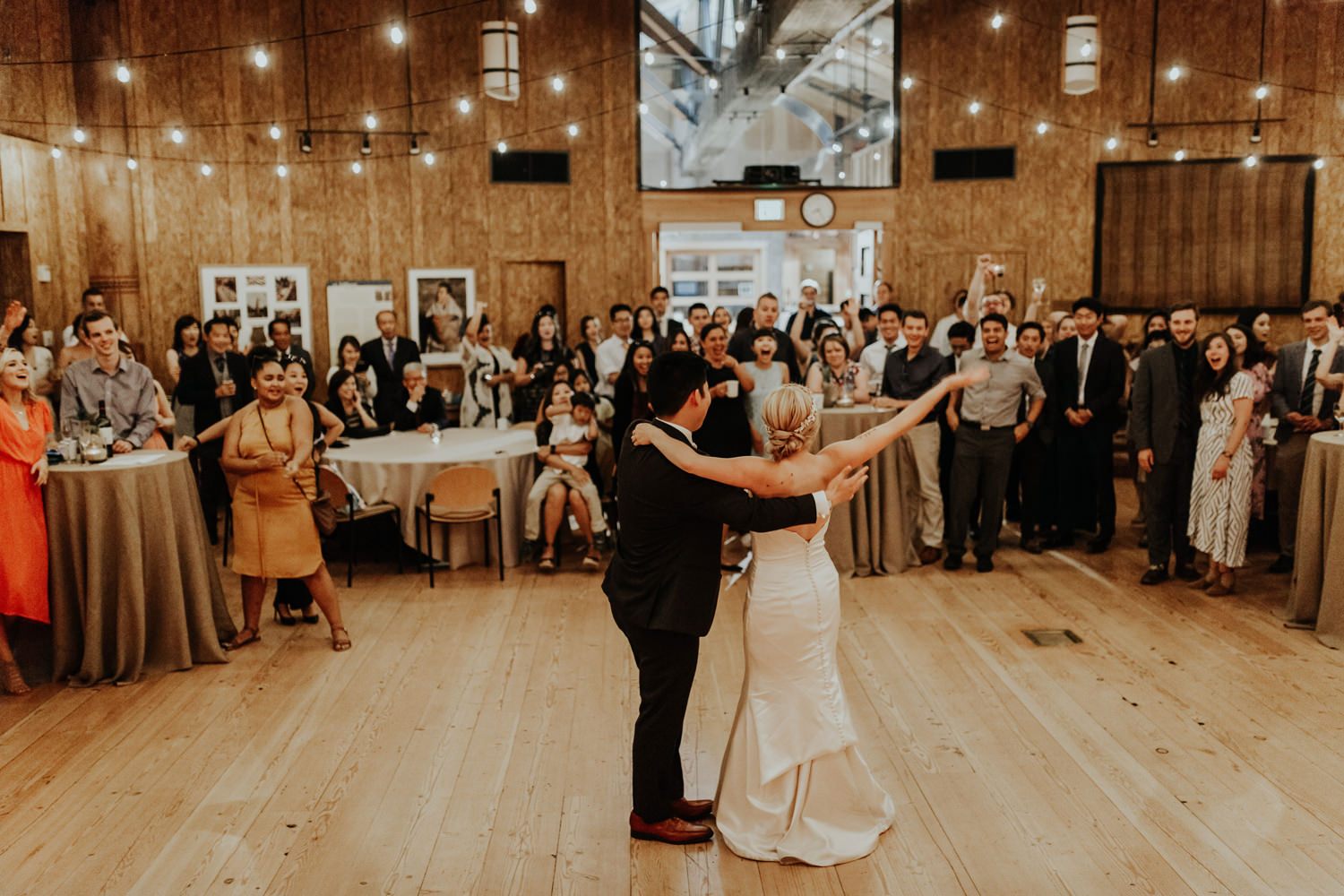 A wedding couples celebrates in the Great Hall.