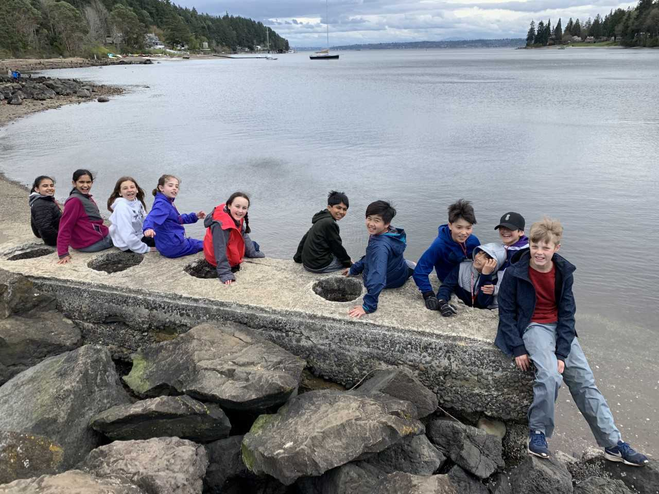 School Overnight Program students sit in a row at Blakely Harbor.