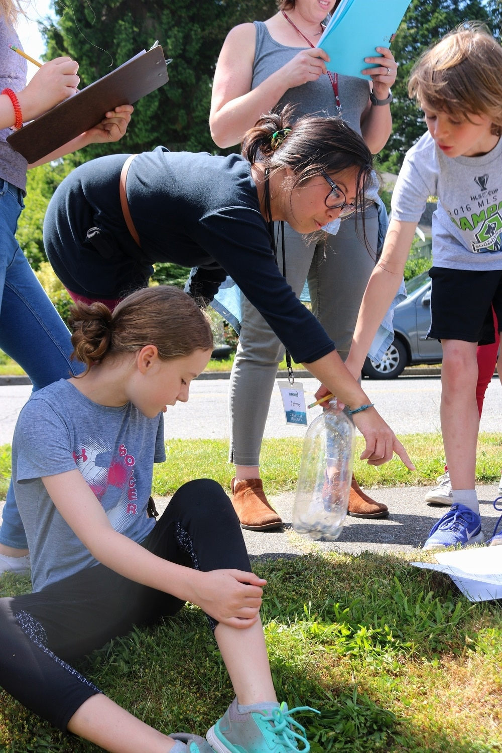 An educator leads students in an exploration of their local environment.