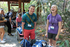 IslandWood Graduate Program students laugh outside the Arrival Shelter.
