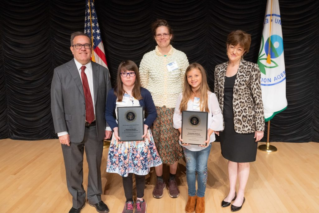 2019 Patsy Collins Award Recipient Sarah Hart and two of her students as they receive the EPA President's Youth Award.