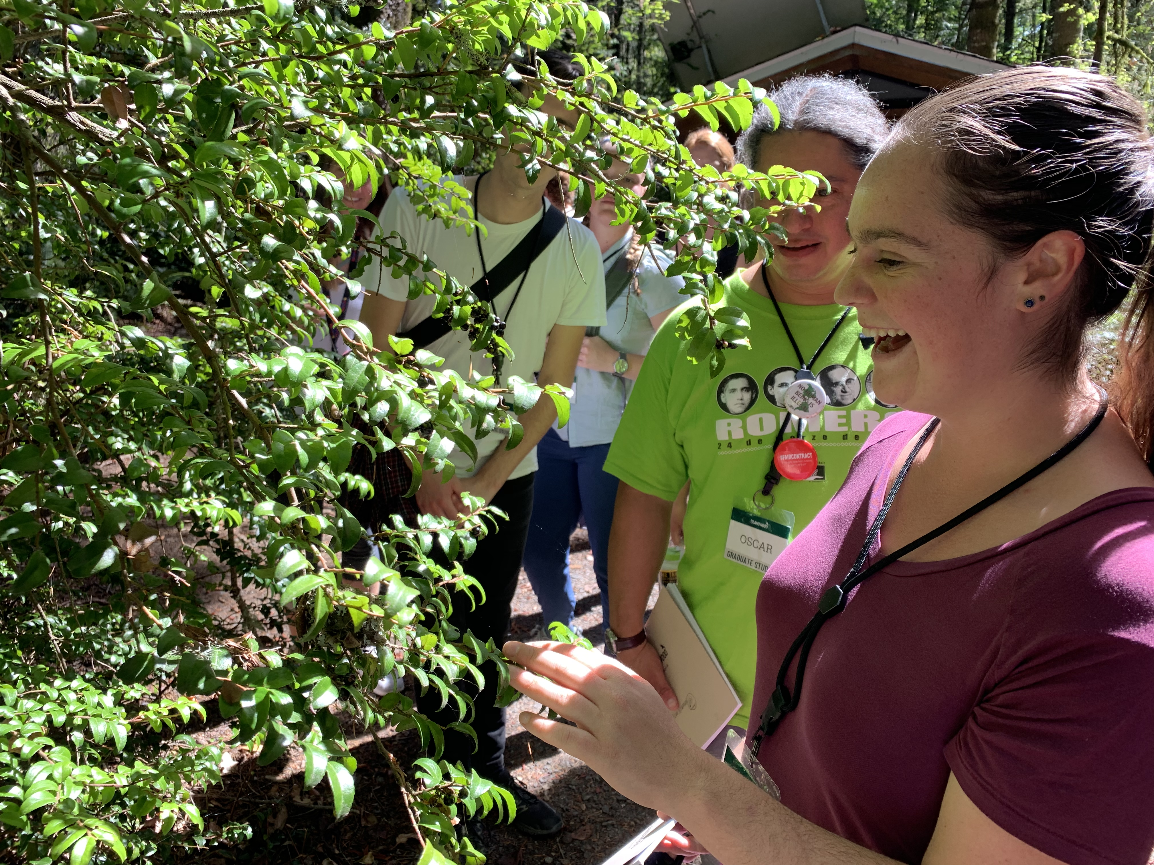 Graduate student Benay O'Connell with an evergreen huckleberry