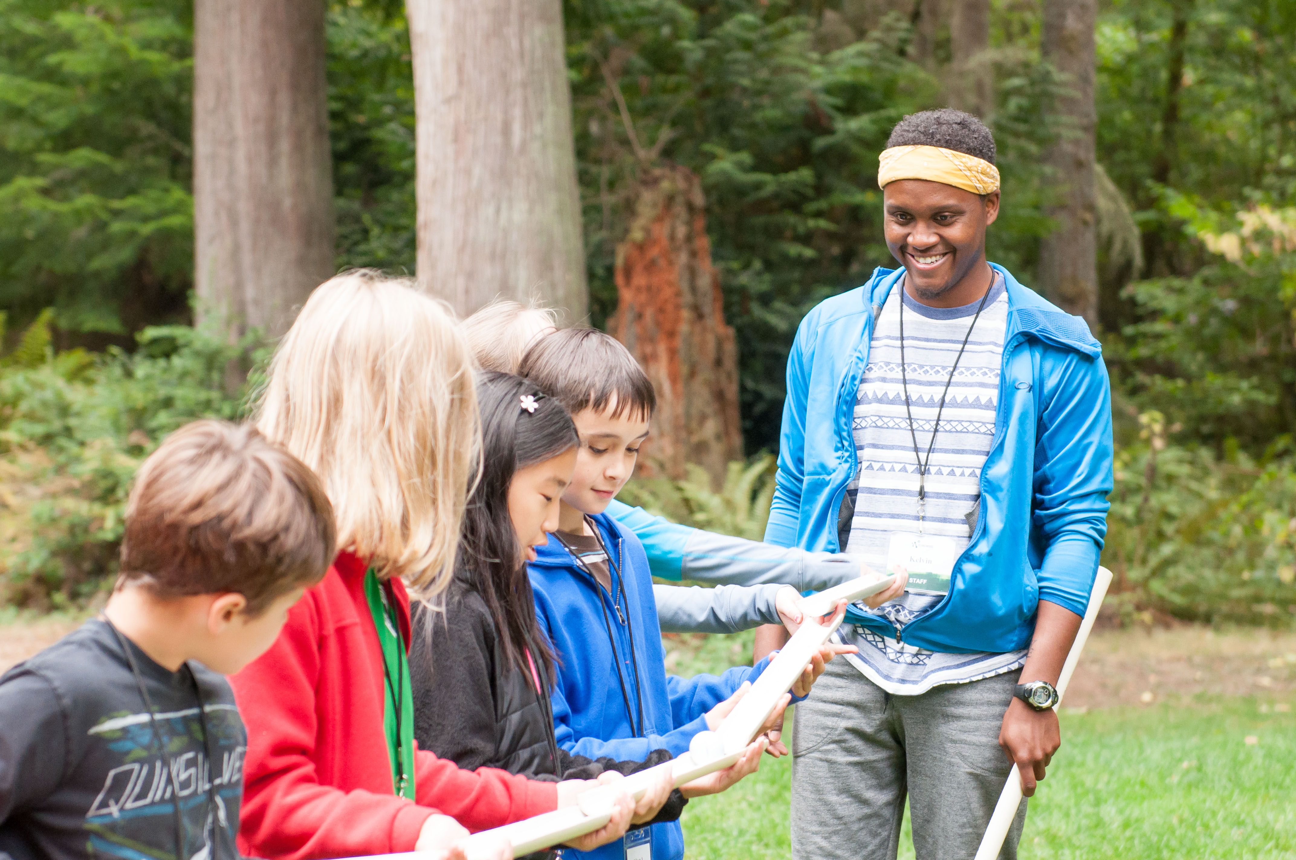 Graduate program alum Kelvin Washington, participating in a team-building exercise with students in the School Overnight Program.