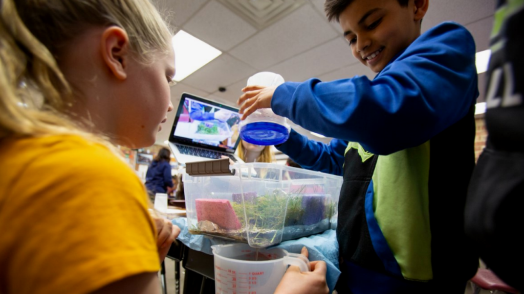 Students create a stormwater model. Image courtesy of: University of Washington College of Education