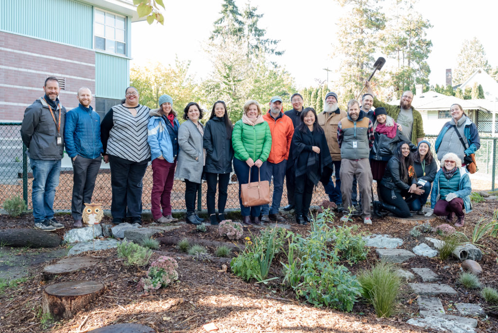 Members of the team that made the Martin Luther King Jr. Elementary rain garden possible, pictured at the rain garden ceremony. Image courtesy of Seattle Public Utilities.