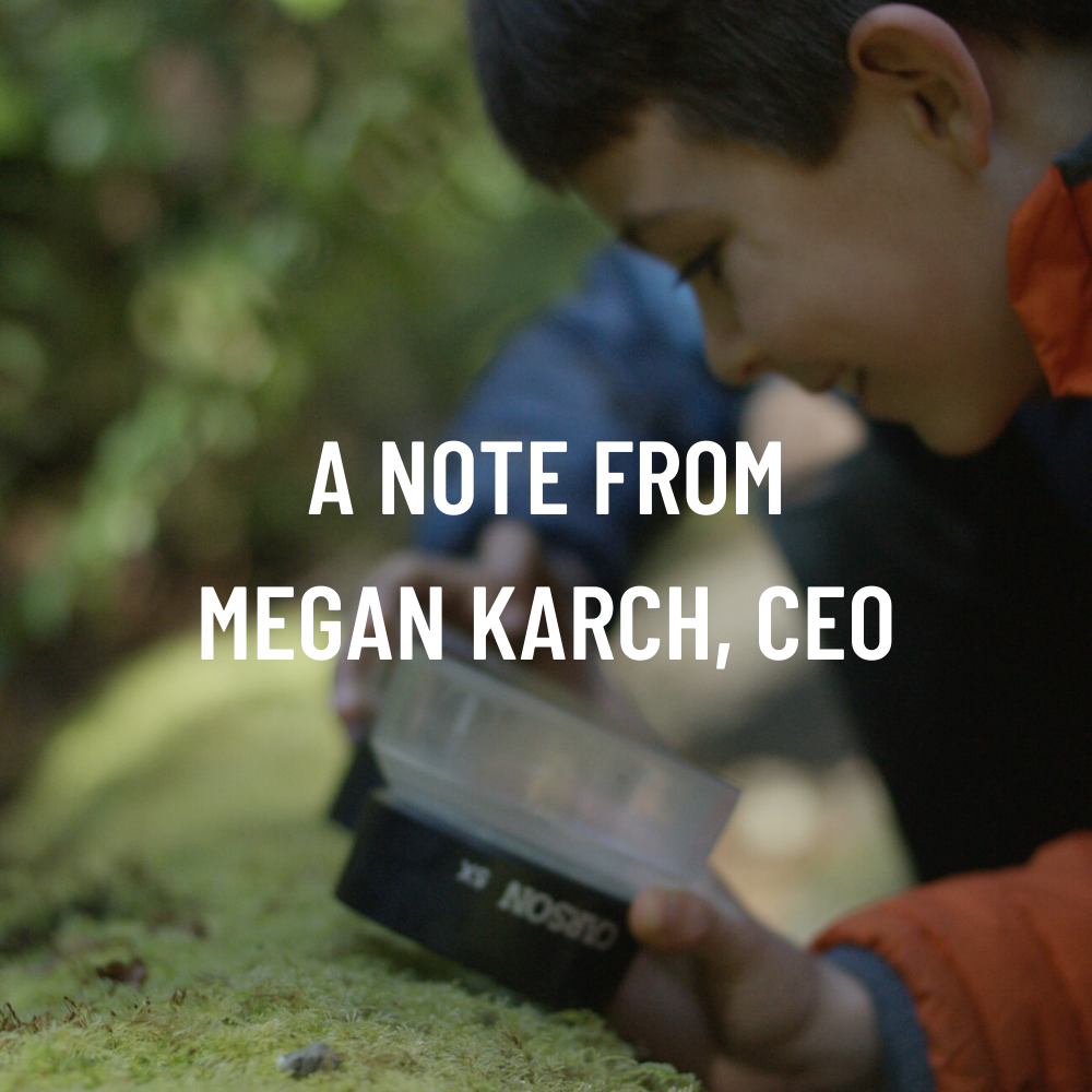 [Image description: a child leans down to look at a nurse log through a magnifying glass. The photo is overlaid with text that reads, 'A Note from Megan Karch, CEO.]