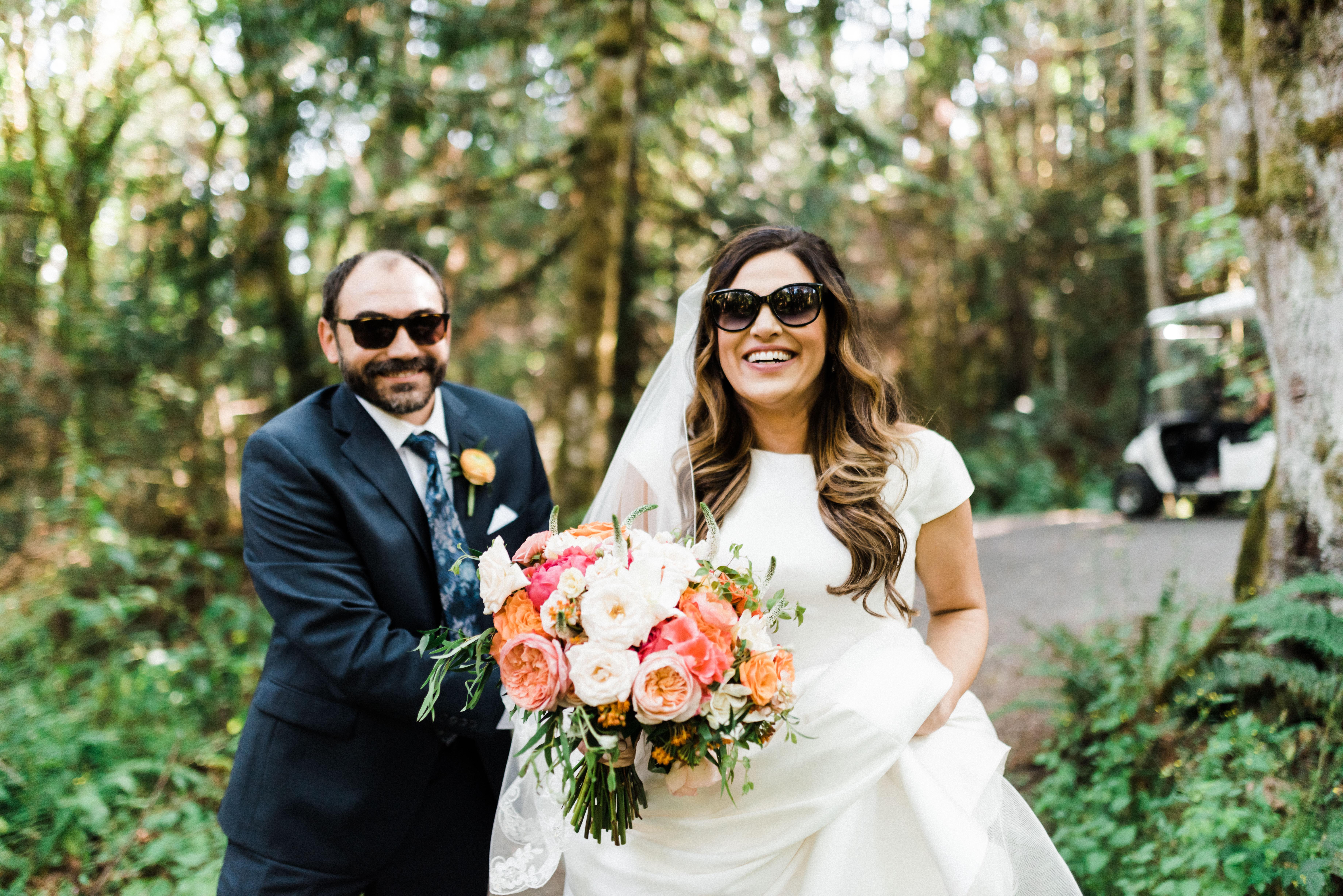 a wedding couple in sunglasses at IslandWood, an Outdoor Wedding Venue