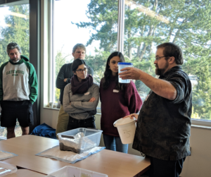 [Image description: Urban School Programs Manager Brad Street leads a group of teachers in a stormwater modeling demonstration.]