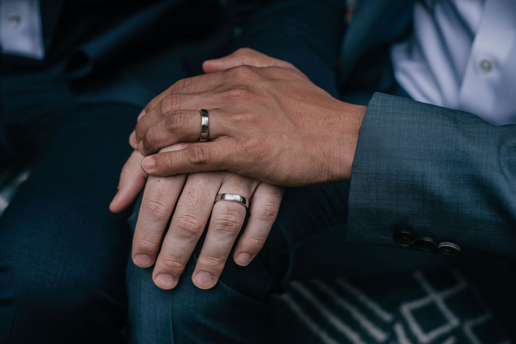 a wedding couple's hands at IslandWood, an Outdoor Wedding Venue
