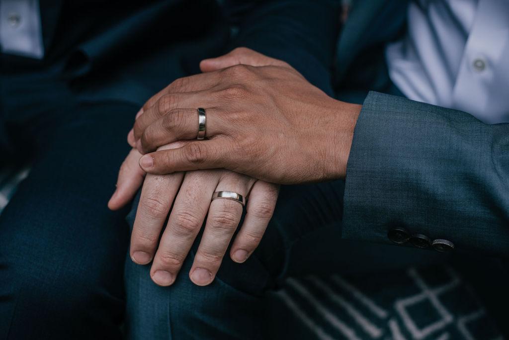 a wedding couple's hands at IslandWood, an Outdoor Wedding Venue