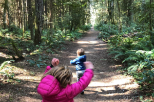 Two kids frolic on the trails on IslandWood's Bainbridge Island campus.